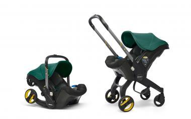 Doona Doona+ 2-in-1 Babyschale mit ausklappbarem Fahrgestell Racing Green